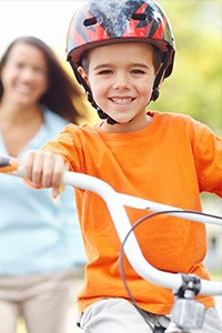 Young Boy Riding Bike